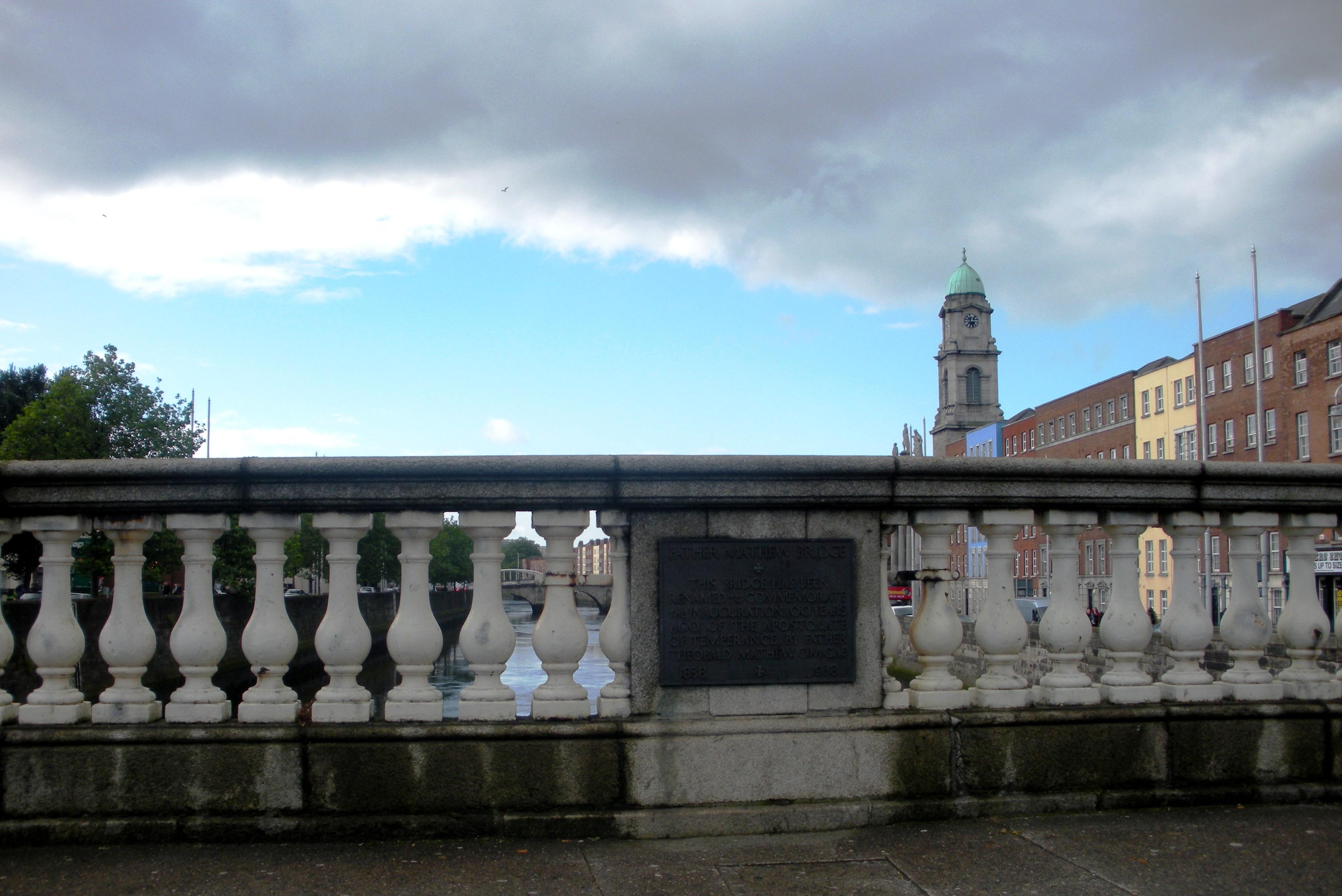 Walking across a bridge over the Liffey River in Dublin