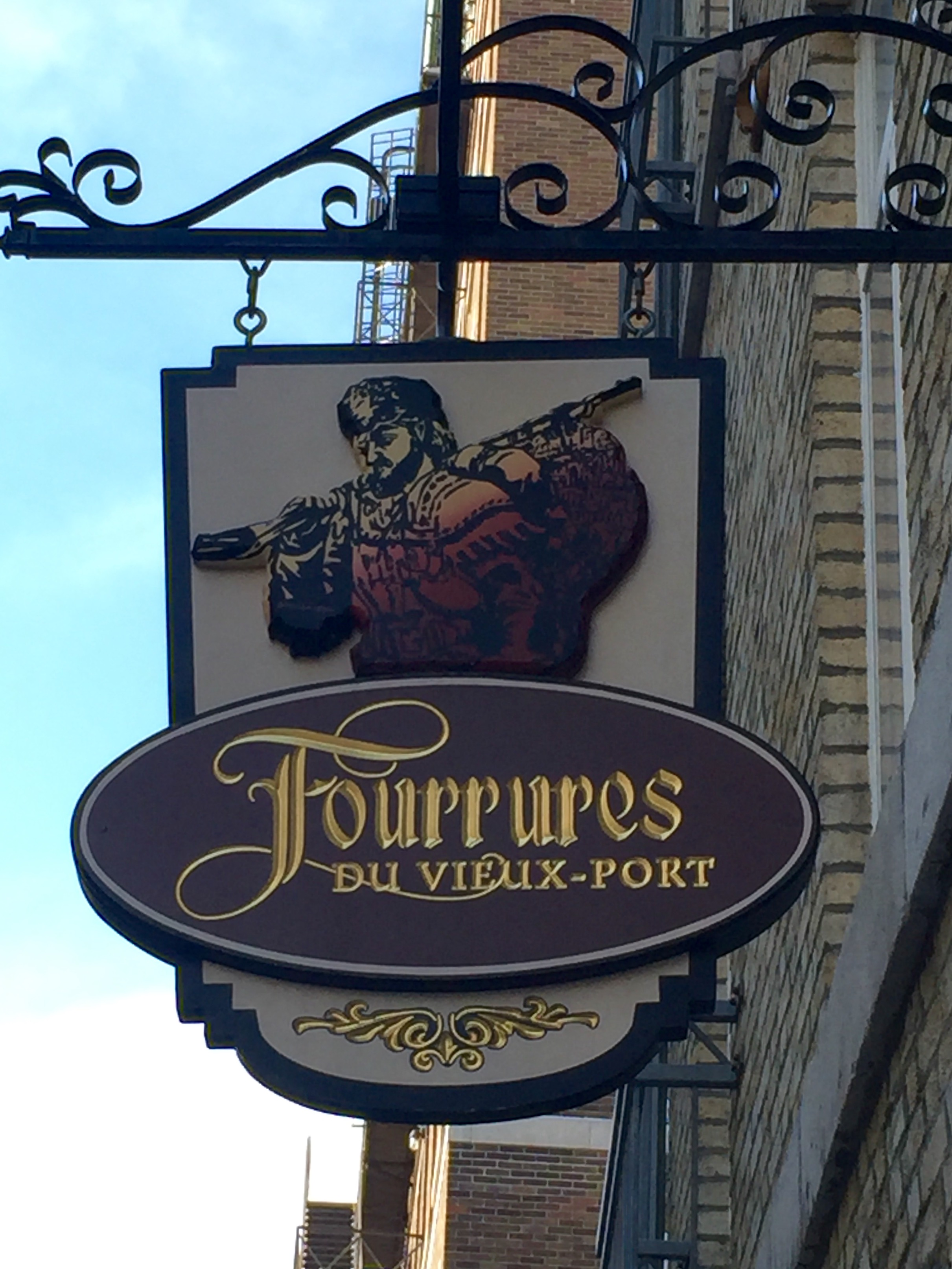An old hanging store sign in Old Quebec City