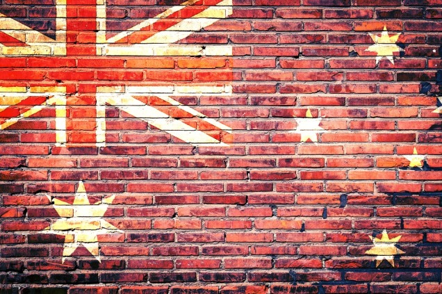 The flag of Australia imposed on a brick wall