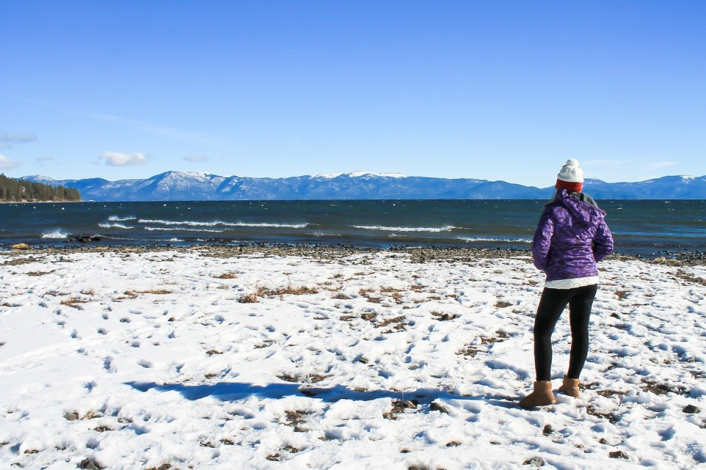 a woman standing close to Lake Tahoe