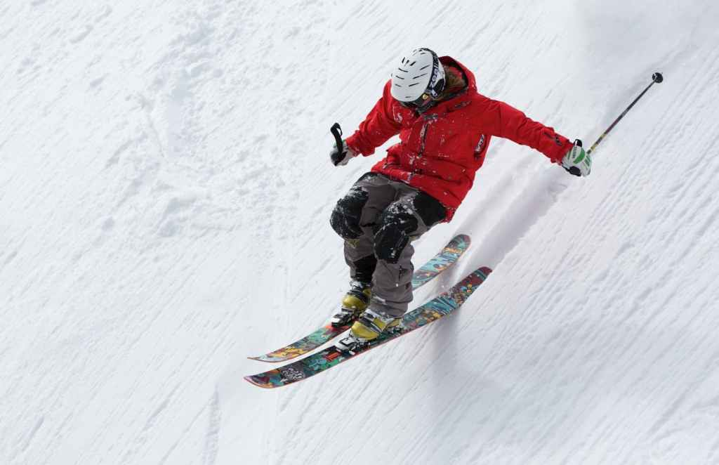 A skier on a black diamond run