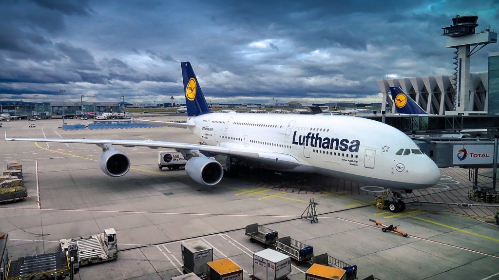 Lufthansa airplane sitting on an airport.
