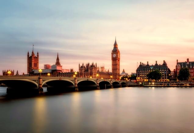 Walk across a bridge in London at sunrise