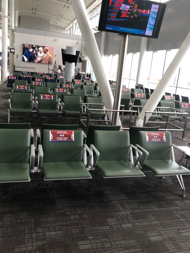 Social Distancing  seats near a gate at Toronto Pearson Airport