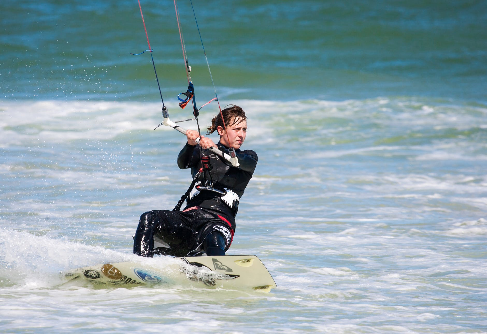 A woman kite surfer looking for her next big wave