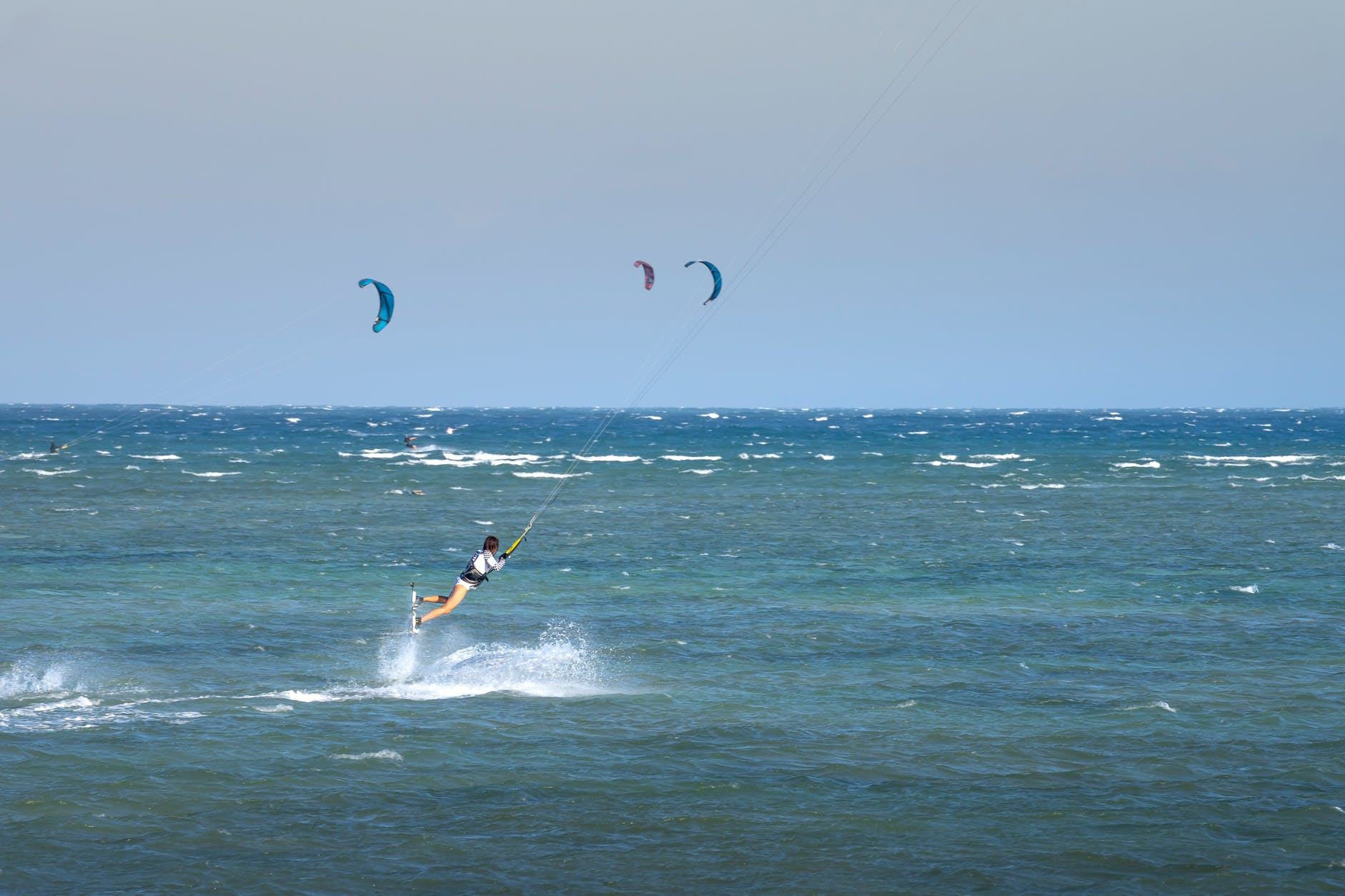 A kite surfer getting some air above the waves