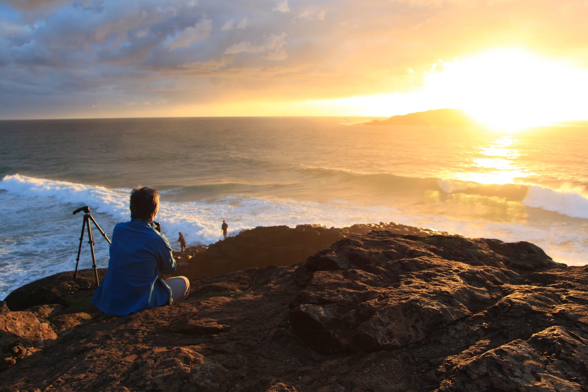 A man looking at sunset from a beach in Australia