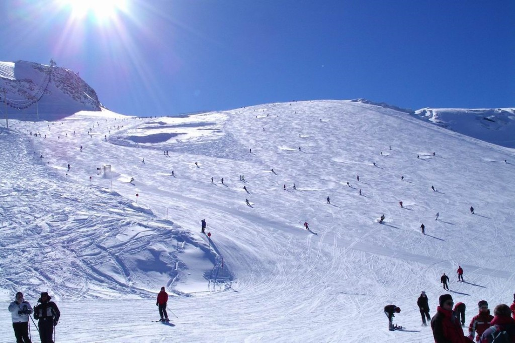 Skiers and snowboarders on the slopes of Austria