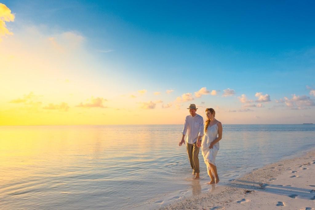 Couple walking on the seashore during sunset