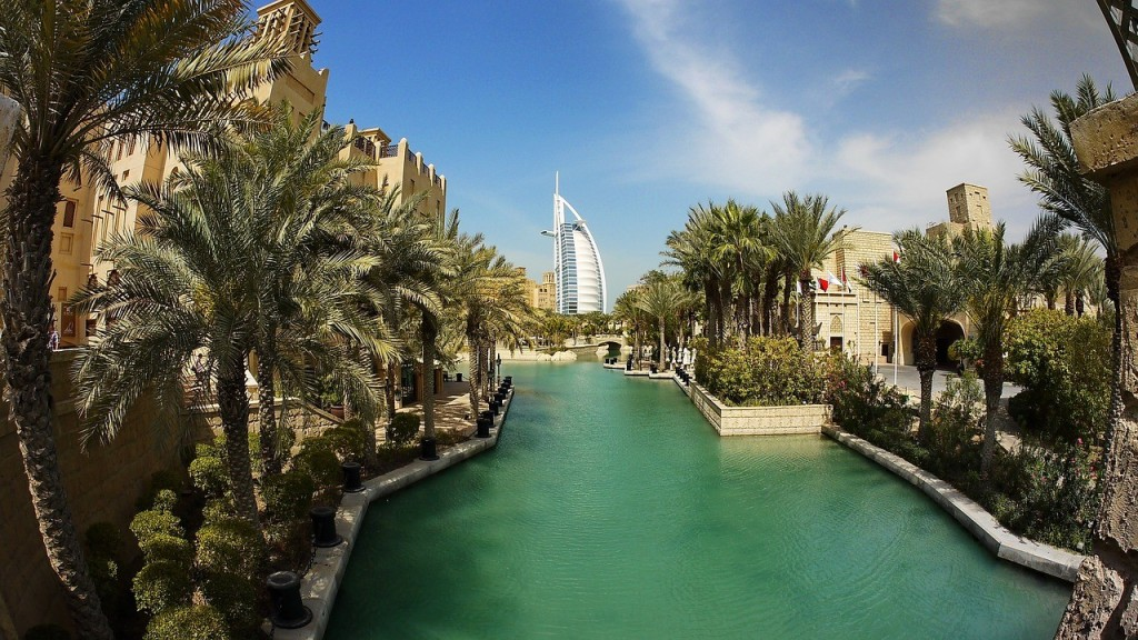 Burj Al Arab hotel, lake, and palms in Dubai